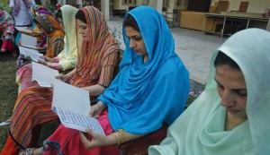 Teachers recite verses from the Koran as they pray for the speedy recovery of schoolgirl Malala Yousufzai in Peshawar